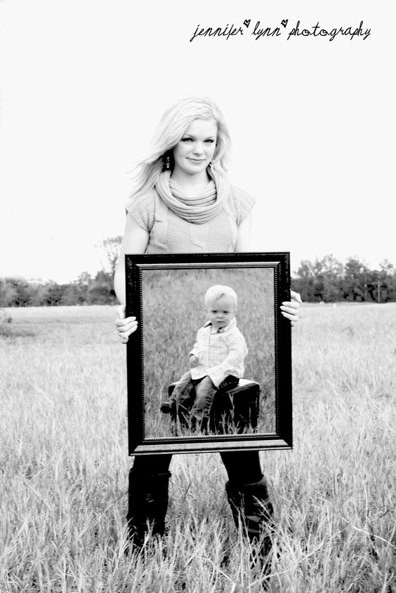 Mother and child... one picture! She's holding a mirror and he's in front of her.: