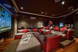 Contemporary Home Theater with Couch - custom built to order, Hardwood floors, Crown molding #hometheaters #crownmolding #harwoodfloors