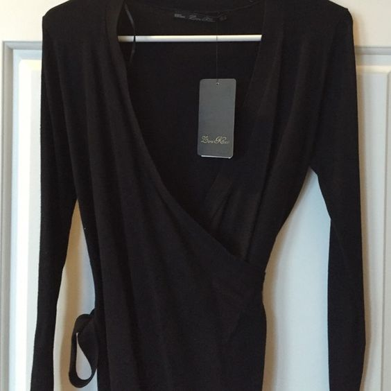 NWT Zara knit top- shirt or cardigan Zara Knit solid black top, NWT. Does not photograph well! It is a wrap top with a side tie. Super soft material. Could be worn as a shirt (with a cami) or a cardigan. Very classic. Zara Tops
