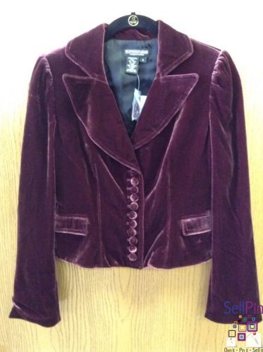 """SellPin.com: Pins for Sale by Owner: J Peterman is the designer and fabulous describes this blazer/jacket. It is a size 4 wine colored velvet. The front of the jacket has two pockets and eleven velvet covered buttons. The sleeves have two velvet covered buttons. There is a classy but sassy double back vent that is accentuated with two velvet covered buttons. Measurements are as follows - (approximate) 17 1/2"""" inches long down center of back  23 inch sleeve length.  $84.95"""