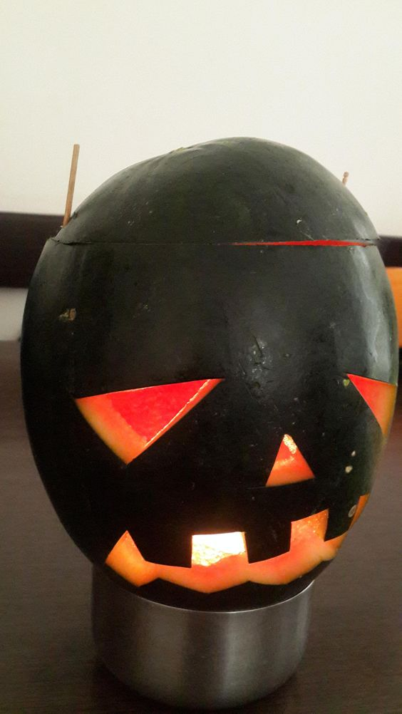 In India we don't get huge size pumpkins... so I carved a watermelon for my son...