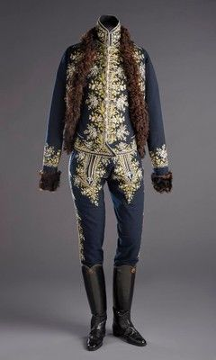 Source: Museum of Applied Arts Approximate year: 1770 - 1780 This is an example of queer fashion in the 18th century due to the fur lining of the tailcoat. Also how shined the boots are.