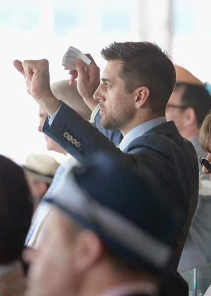 Green Bay Packers quarterback Aaron Rodgers celebrates a pre-Derby race at Churchill Downs.