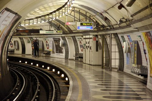 Station on the London Underground. The random thing that always strikes me about Underground platforms is you can arrive on it and it will be empty, and within a few seconds be teeming with life