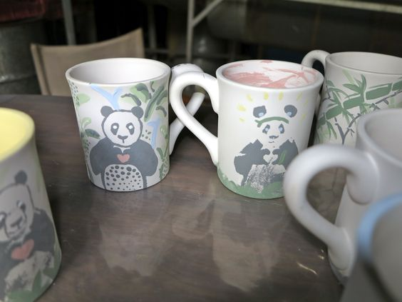 Everyone loves a Ninja Panda.  Look at the creativity in these few mugs awaiting their clear glaze and firing.  Come to Cork and Chroma for a Ceramics painting night soon!
