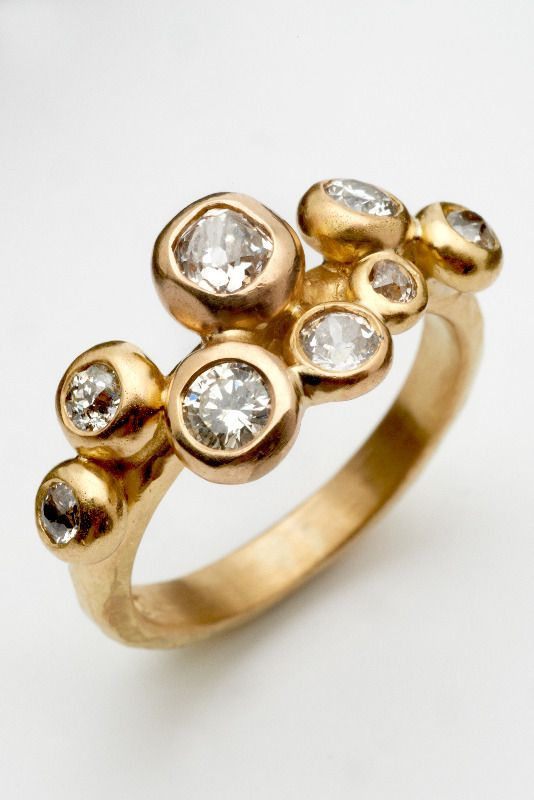 I just fell in love with this ring! http://www.malcolm-morris.com/rings.html