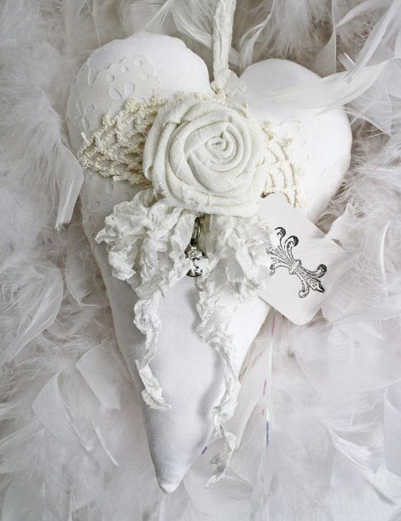 White fabric heart with linen flower: