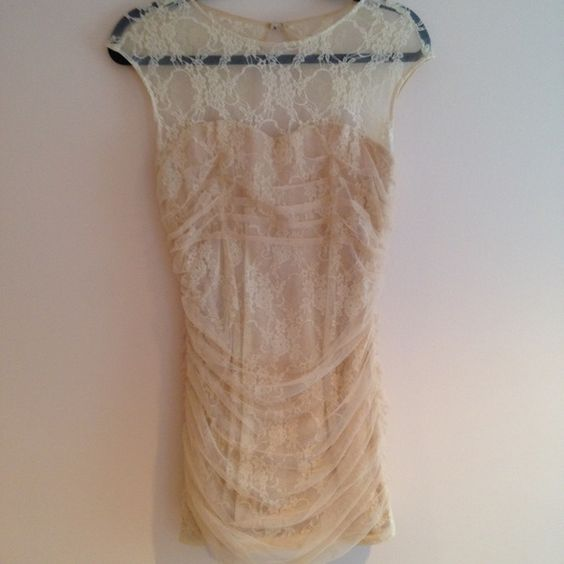 En Creme Beige Lace Dress Super cute Lacey dress with sheer cat sleeves- worn only once - perfect condition NWOT En Creme Dresses Mini