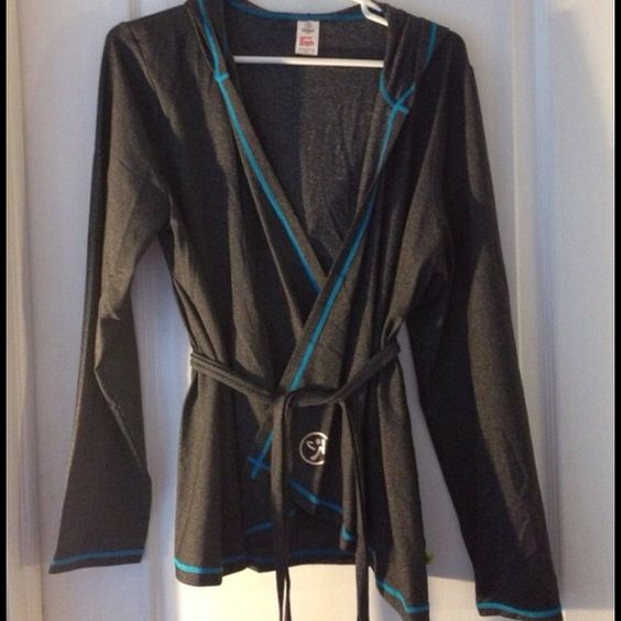 CHARCOAL GRAY ZUMBA WORKOUT JACKET This is the El Fab Futuro charcoal gray hooded Zumba workout jacket. It is long sleeved and has turquoise trim, and has a pretty gold print in back. Zumba logo in front. Worn once. Zumbawear Jackets & Coats