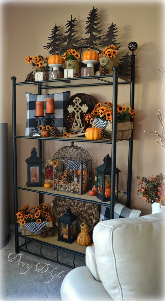 Here is a look at how I decorated the etagere that stands in the far corner of our living room.  Although it usually takes me awhile to ge...