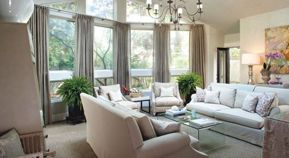 Family room with vaulted ceiling and wall of windows