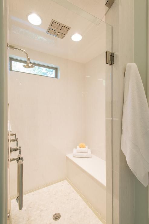 Fabulous white shower features a white tile surround