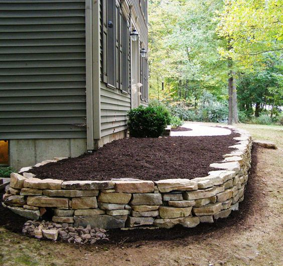 Beds flower beds and stacked stones on pinterest for Flower beds in front of house