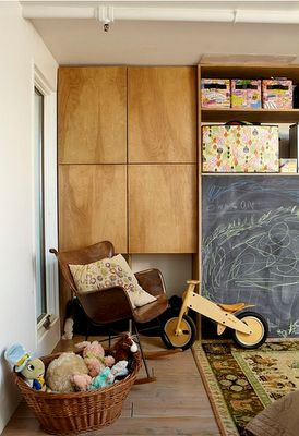 Family room love the cupboards and chalkboard wall!