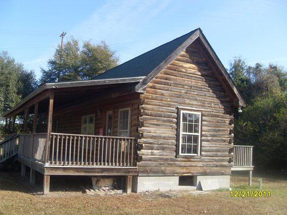 Log cabin siding lowe 39 s plank siding brick veneer for Brick cabin