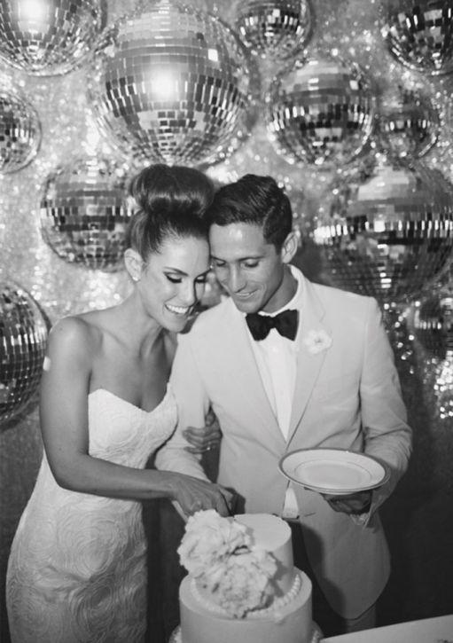 A disco ball backdrop is one way of glamming up your wedding! ... add #diy www.customweddingprintables.com