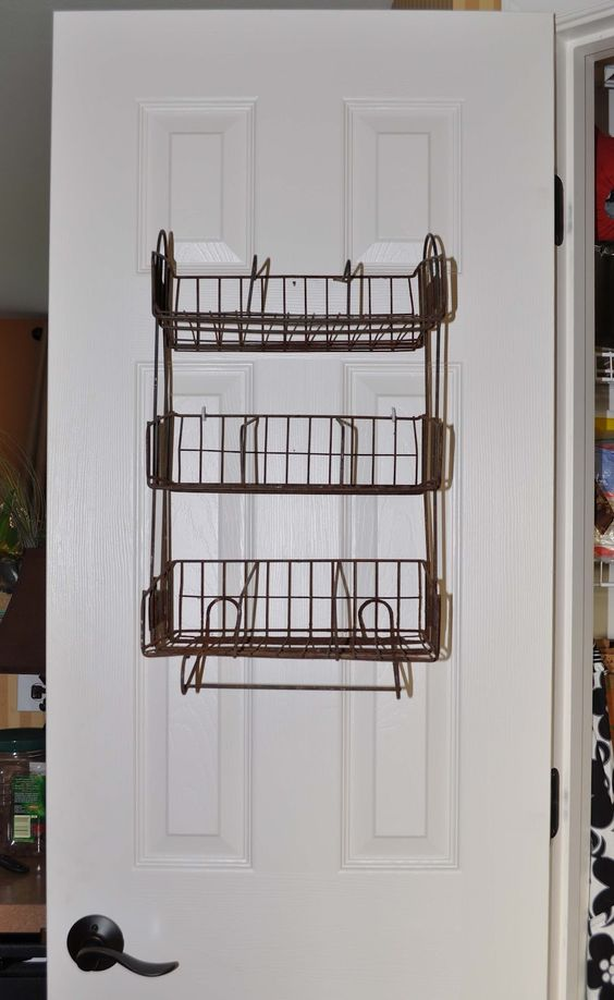Country Style Wall Mounted Spice Rack with Three Space to Save the Spice Jars also the Rack Located on the Behind the Door for Wall Hanging Kitchen Accessories Decorating Ideas
