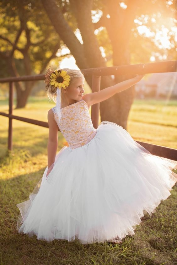 Like a ray of sunshine...  Pretty little flower girl dress in white and yellow.  Custom made to fit your pretty girl.   See more here: https://www.etsy.com/listing/477163969/sunflower-dress-sequin-dress-white-dress?ref=shop_home_active_3