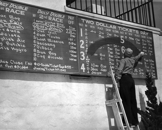"Old school odds and results chalk board at Del Mar.  This is where the phrase, ""Betting on the chalk"" (meaning betting on the favorite) started."
