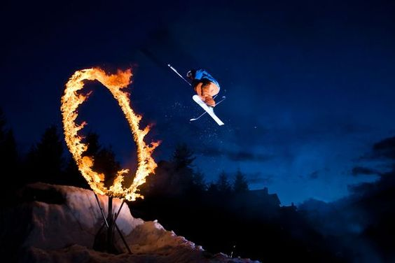 a crazy skier in Whistler, Canada, jumping through a ring of fire.