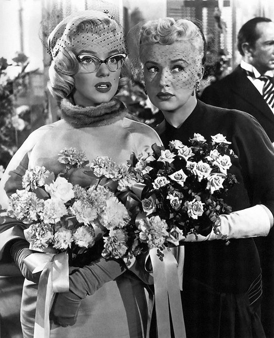 Marilyn Monroe (as Pola) and Betty Grable (as Loco) in How to Marry a Millionaire. (1953)