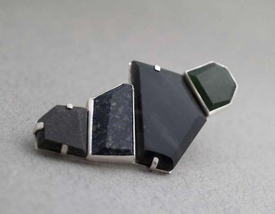 KZ907  Tama brooch - stg silver, grey wacke, lapis, NZ obsidian, pounamu  $520