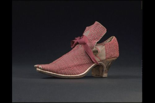 Also from the 1660s, this woman's shoe has pink ribbon painstakingly hand-applied to the leather.