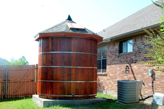 Wednesday, July 24, 2013 -Building Our 3,000 Gallon Western Red Cedar Rainwater Cistern = Here in north Texas we experience frequent dry conditions in the summer.  We built a rainwater collection cistern out of western red cedar and use the collected water for irrigating our trees and landscaping.  The cistern holds 3000 gallons of water and is approximately 8 feet tall (not including roof height) and 8 feet in diameter.: