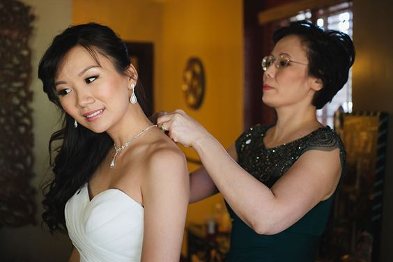 Mom of the Bride helping with final touches! // Shop the attire and accessories from this LA wedding at shopmrmrs.com