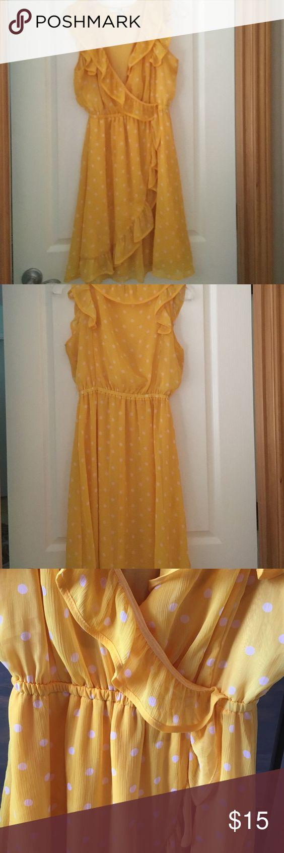 Sunshine yellow polka dot sun dress Cheery and girly polka dot dress. Has cute flounce all around collar and crosses skirt part. Forever 21 Dresses Mini