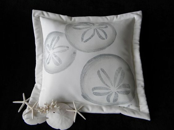 """Sand dollar pillow painted 20"""" indoor outdoor all weather beach coastal cottage cabin vacation echinoderm seashell shelling. $38.00, via Etsy."""