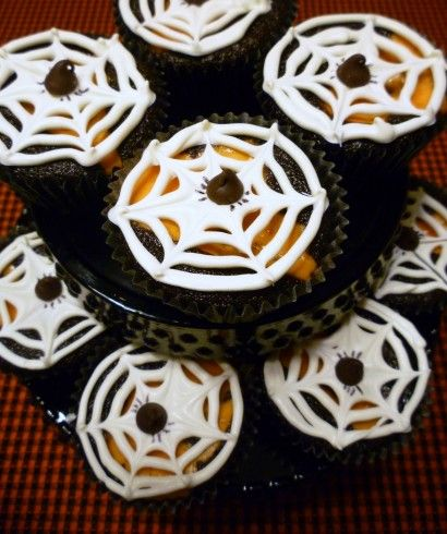 This is a traditional Black Bottom Cupcake, with orange colored filling and a white chocolate spider web on top!