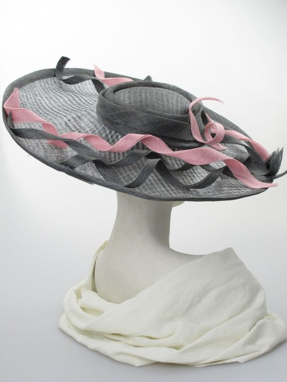 Asymmetric brim hat (back view) | Label: Judy Bentinck | Dark grey and pink sinamay and 'windowpane' large sloping picture hat. Summer wear | Made in England