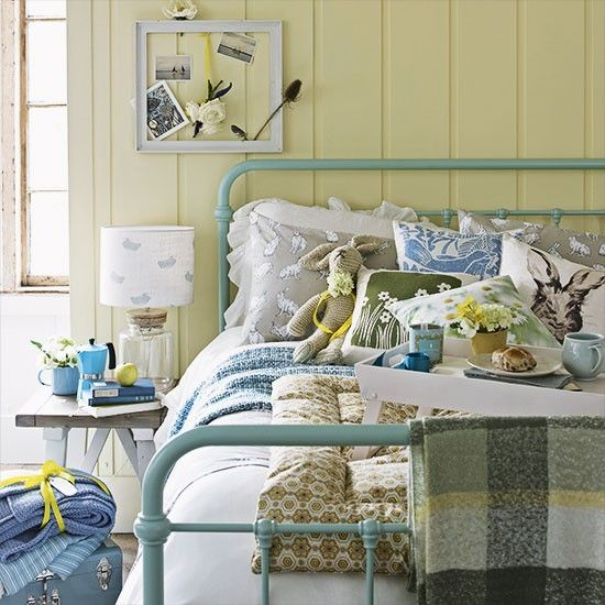 Yellow country bedroom with blue bedstead   Bedroom   Country Homes & Interiors   Housetohome.co.uk