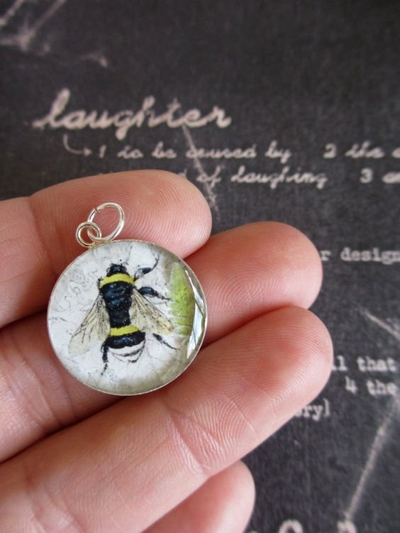 The Beekeeper ( Etsy:: http://www.etsy.com/listing/115220475/the-beekeeper-vintage-bee-collage-under?# )