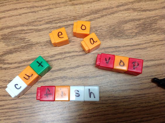 Unifix cube word builders Use unifix cubes to practice nonsense and short spelling words.  Place vowels in one color, and the rest of the alphabet in various other colors.  Make several sets of each for multiple kids.  Makes a great center or Title 1/ special education activity!