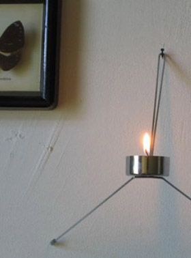 FireFly - wall mounted candle holder by Chris Koens at Invotis Orange Studio