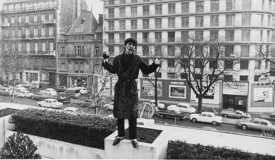 February 8, 1964: Beatle George Harrison on the balcony of the Plaza Hotel, New York City. He was sick with 103 degree temperature and strep throat so was on bed-rest for several days.