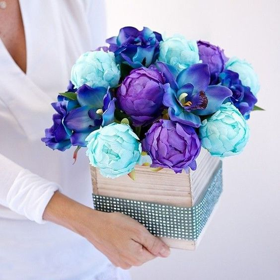 Aqua peonies and beautiful blue orchids makes for a