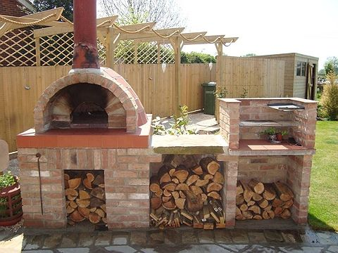 Wood fired pizza oven.... love the rustic, real italian feel to it...