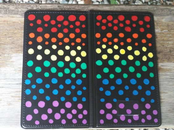 Check out this item in my Etsy shop https://www.etsy.com/listing/240080790/hand-painted-server-book-rainbow-design