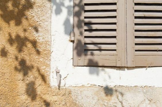 Another traditional wooden shutters.The shadows are made by the grape leaves.