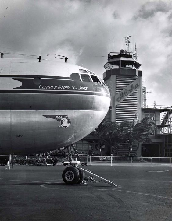 The Pan American Boeing Clipper Glory of the Skies parked in front of the original control tower at Honolulu International Airport (ca. 1956)