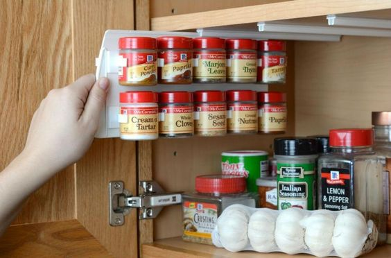 Install a pull out spice rack to the underside of a cabinet.