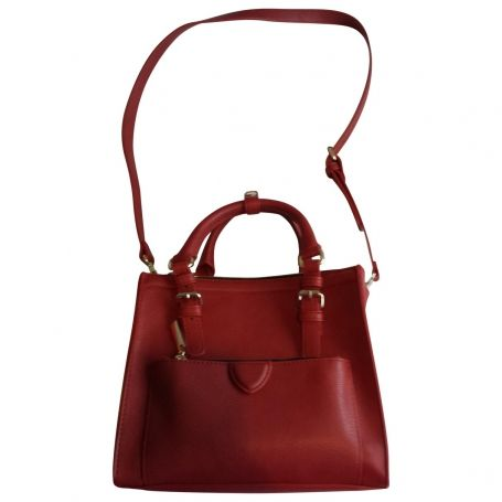never worn, beautiful dark red colour, perfect for autumn-winter, removable starp.  Leather finish, tag says 100% polyurethan