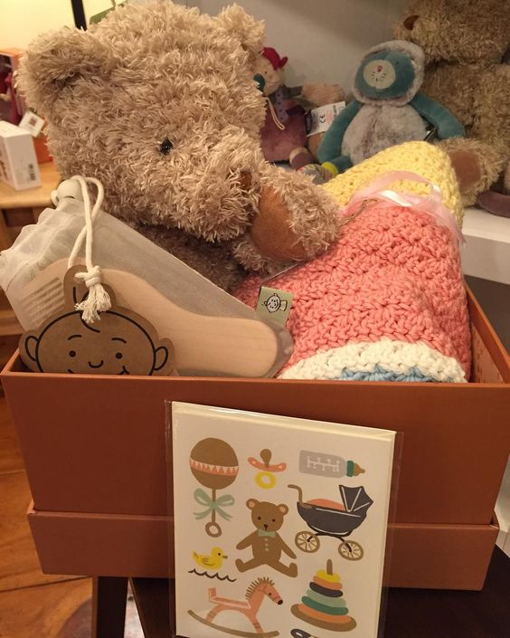 Here is our wonderful Teddy, a beautiful handmade baby blanket, wooden brush and a new baby card all in one spot!! Shop small business and local❤️