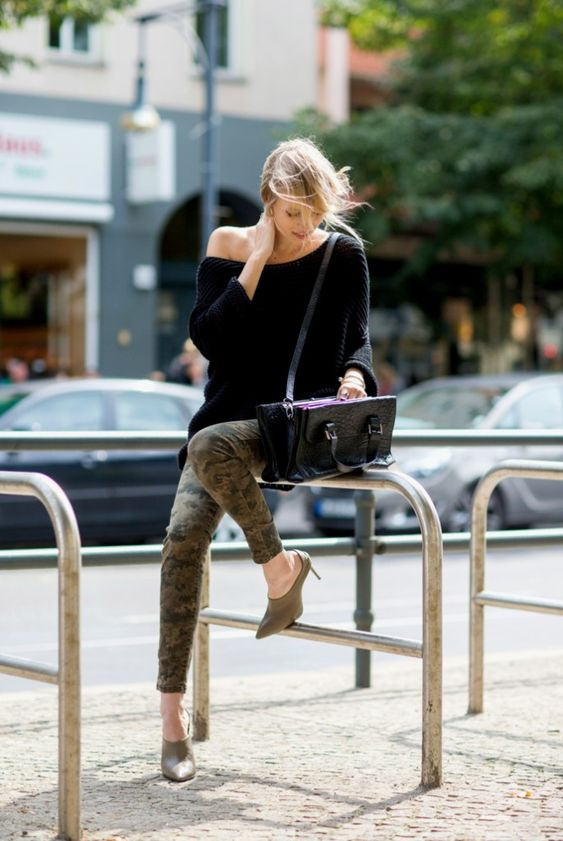 Leonie Sophie is wearing camouflage trousers from Cinque