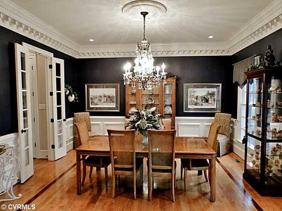 Black dining rooms dining room walls and white trim on for Black dining room walls