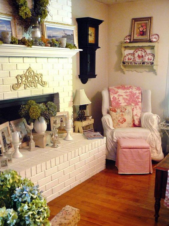 Quaint Space  RMS user countrycottagegirl admits she is not a minimalist and loves to display her hydrangeas, transferware and collected accessories. Although she's dealing with a small living space, the shabby chic style instantly turns this room into a cozy retreat.