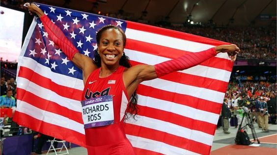Sanya Richards-Ross of the United States celebrates winning gold in the Women's 400m Final on Day 9.